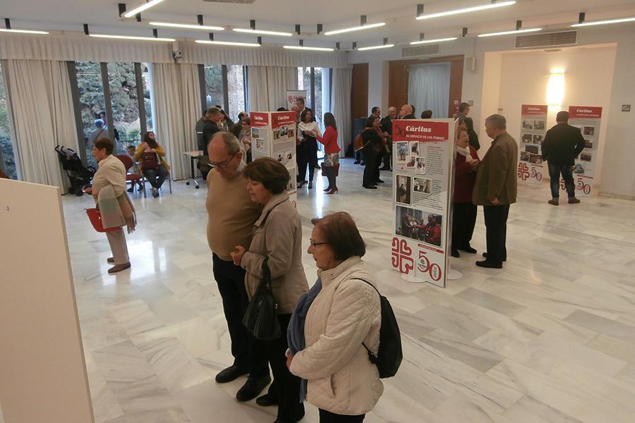 Inauguración de la exposición de Cáritas por su 50 aniversario en la casa hermandad de Estudiantes// CÁRITAS MÁLAGA